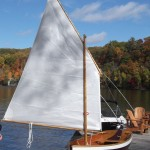 This Drifter arrives at her new home - Lovely with the wood interior  sail and row boat version