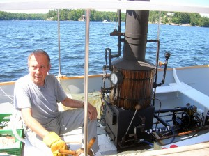George Lang on his Steamboat - Boat built by Mark